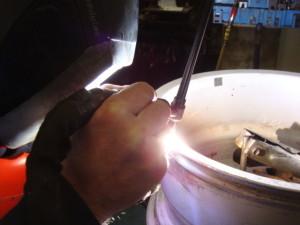 TIG welding of an alloy wheel.