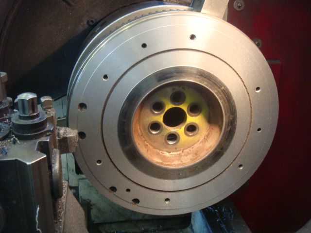 Flywheel being faced off using carbide tooling on our large lathe